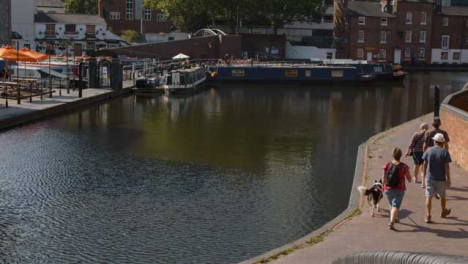 Panning-Shot-of-People-with-Dog-Walking-Canalside-In-Birmingham-