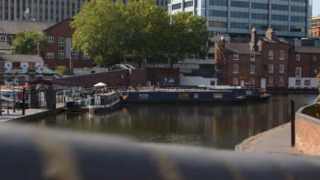 Panning-Shot-of-Canal-Boats-Moored-In-the-Birmingham-Canal-