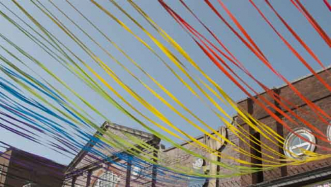 Panning-Shot-of-Decorative-Ribbons-Tied-to-Building-