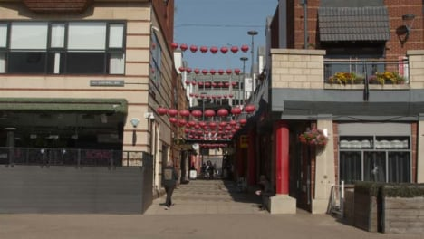 Wide-Shot-of-Narrow-Street-with-Chinese-Lantern-Decorations
