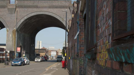 Tracking-Shot-of-Road-Running-Underneath-Bridge-In-Birmingham