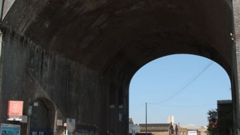 Tilting-Shot-of-Bridge-Archway-Over-Road-In-Birmingham-