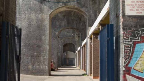 Tracking-Shot-of-Archways-Underneath-Bridge-In-Birmingham-