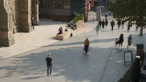 High-Angle-Shot-of-People-Walking-Around-City-Centre-In-Birmingham