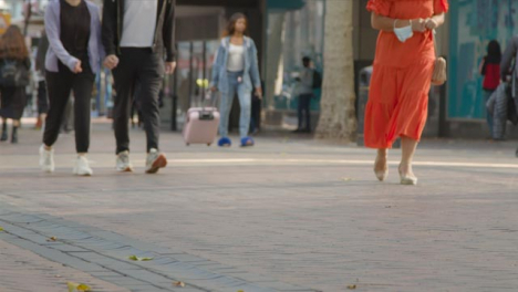 Defocused-Shot-of-Feet-Walking-Through-Busy-Street-In-Birmingham