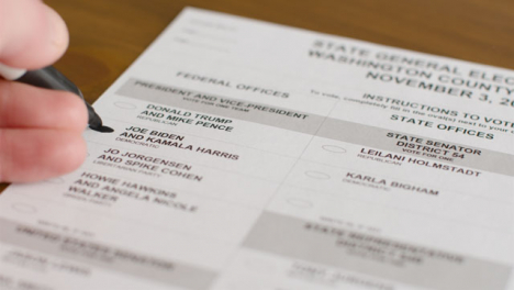 Close-Up-Hand-Voting-for-Joe-Biden-on-Ballot-Paper-in-US-Election