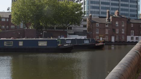 Panning-Shot-of-Canal-Boats-Moored-In-Birmingham-Canal-