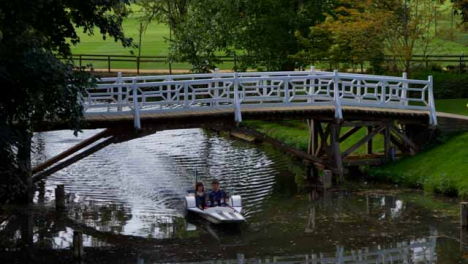 Wide-Shot-of-Two-People-In-Peddle-Boat-On-River-In-Oxford