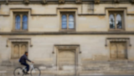Defocused-Shot-of-Traffic-and-People-Travelling-Down-High-Street-In-Oxford-01