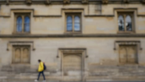 Defocused-Shot-of-Traffic-and-People-Travelling-Down-High-Street-In-Oxford-03
