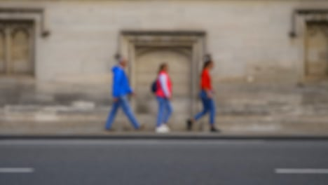 Defocused-Shot-of-People-and-Traffic-Travelling-Down-High-Street-In-Oxford-01-