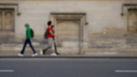 Defocused-Shot-of-People-and-Traffic-Travelling-Down-High-Street-In-Oxford-02