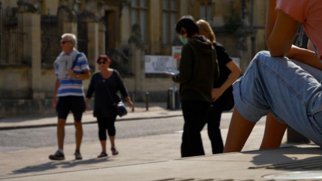Wide-Shot-of-People-Socialising-On-Street-as-Traffic-Goes-By-In-Oxford-02