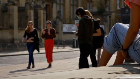 Wide-Shot-of-People-Socialising-On-Street-as-Traffic-Goes-By-In-Oxford-03