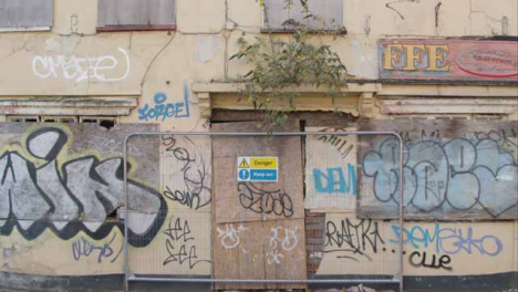 Wide-Shot-of-Boarded-Up-and-Dilapidated-Building-In-Bristol-England