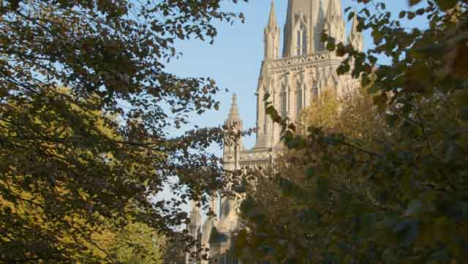 Tracking-Shot-of-St-Mary-Redcliffe-Church-Through-Some-Trees-In-Bristol-England