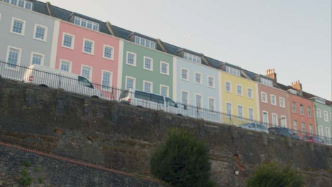 Low-Angle-Tracking-Shot-of-Colourful-Town-Houses-In-Bristol-England-