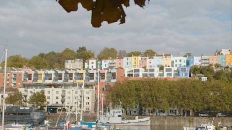 Tracking-Shot-Revealing-Colourful-Waterside-Town-Houses-In-Bristol-England