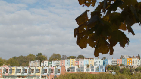 Tilting-Shot-of-Colourful-Waterside-Town-Houses-In-Bristol-England