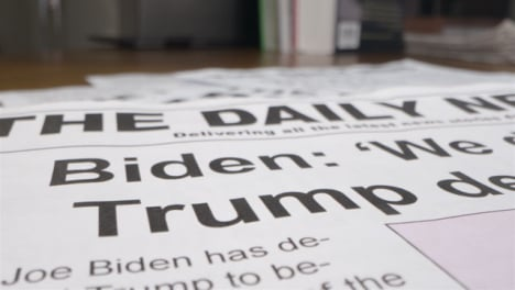 Close-Up-Newspaper-Headlines-on-Biden-Winning-Election