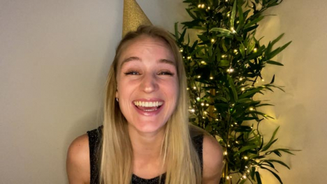 Young-Woman-On-Video-Call-Counting-Down-to-Midnight-and-Celebrating-Turn-of-New-Year