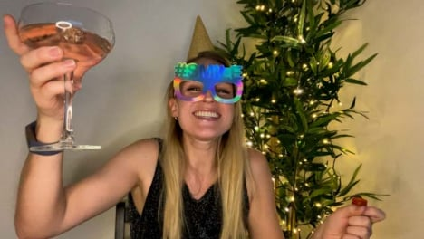 Young-Woman-On-Video-Call-Counting-Down-to-Midnight-and-Celebrating-Turn-of-the-New-Year