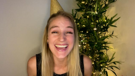 Young-Woman-On-Video-Call-Countdown-to-New-Year-and-Celebrating-with-Party-Popper