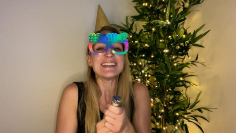 Young-Woman-On-Video-Call-Countdown-to-New-Year-and-Celebrating-with-a-Party-Popper