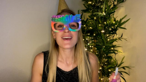 Young-Woman-On-Video-Call-Countdown-to-Midnight-and-Celebrating-New-Year