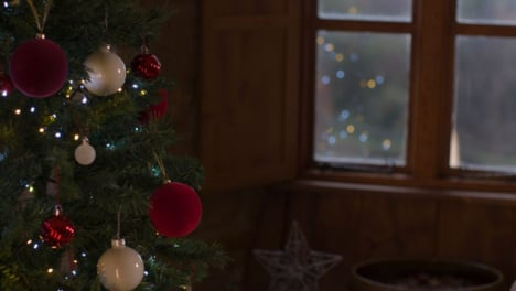 Pull-Focus-Shot-From-Christmas-Tree-to-Cold-Winter-Weather-Outside