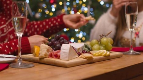 Close-Up-Shot-of-Couples-Table-Food-Spread-During-Christmas-Celebrations-