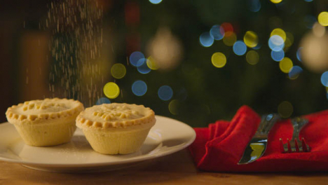 Sliding-Extreme-Close-Up-Shot-of-Icing-Sugar-Falling-Onto-Mince-Pie-