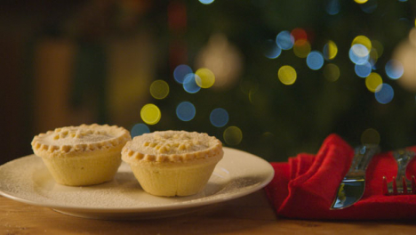 Sliding-Extreme-Close-Up-Shot-of-Two-Mince-Pies-On-Plate-