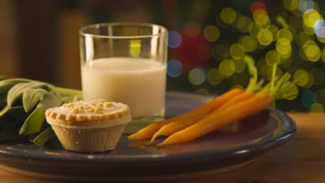 Sliding-Extreme-Close-Up-Shot-of-Sage-Carrots-Mince-Pie-and-Glass-of-Milk-On-Plate