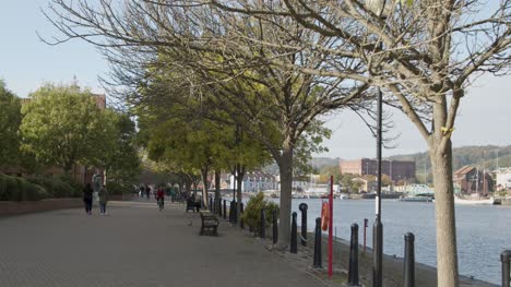 Tracking-Shot-Along-Busy-Waterside-Pathway-In-Bristol-England