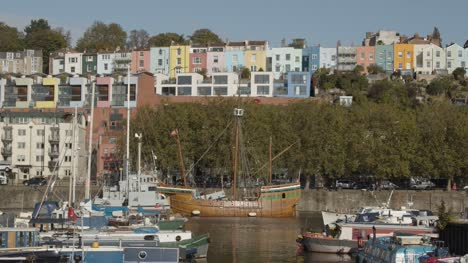 Wide-Shot-of-Ship-Sailing-Through-Bristol-Marina-In-Bristol-England