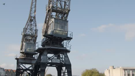 Tilting-Shot-of-Old-Disused-Cranes-at-Dock-In-Bristol-England