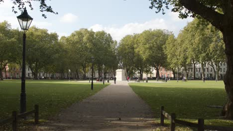 Tracking-Shot-Approaching-Equestrian-Statue-of-William-III-In-Queen-Square-In-Bristol