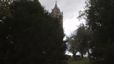 Sliding-Shot-Revealing-Cabot-Tower-From-Behind-Trees-In-Bristol