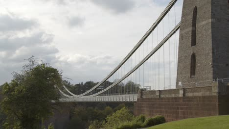 Sliding-Shot-From-Behind-Tree-Revealing-Clifton-Suspension-Bridge-In-Bristol-