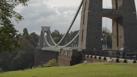 Sliding-Shot-From-Behind-Tree-Revealing-Clifton-Suspension-Bridge-In-Bristol-England