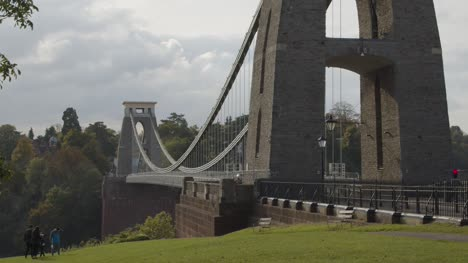 Sliding-Shot-From-Behind-Tree-Revealing-Clifton-Suspension-Bridge-