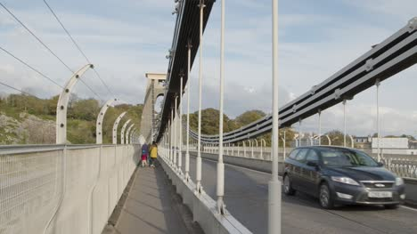 Tracking-Shot-of-Family-Walking-Across-Clifton-Suspension-Bridge-In-Bristol-England