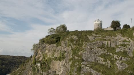 Tilting-Shot-of-Cliff-Face-Overlooking-River-Avon-and-Clifton-Observatory-In-Bristol