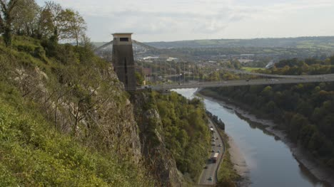 Tilting-Shot-of-the-Clifton-Suspension-Bridge-and-River-Avon-In-Bristol-England
