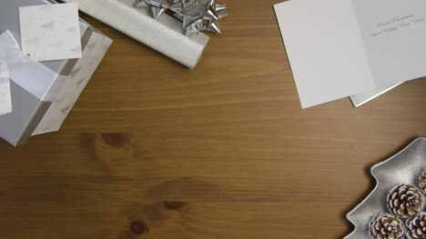 Top-View-of-Christmas-Themed-Table-Surface-Background-with-Central-Copy-Space