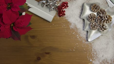 Overhead-of-Christmas-Themed-Table-Surface-Background-with-Left-Central-Copy-Espacio