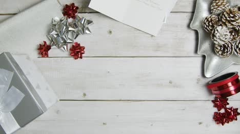 Overhead-View-of-Christmas-Themed-Table-Surface-Background-with-Central-Copy-Espacio
