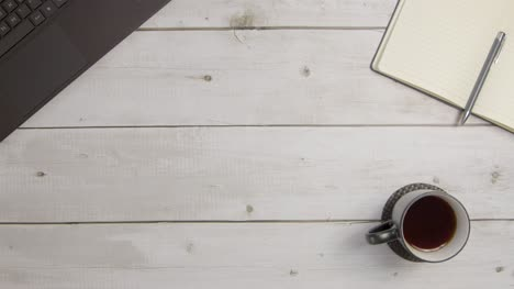 Overhead-Shot-of-Rustic-Desk-Surface-Background-with-Central-Copy-Space