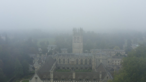 Drone-Shot-Approaching-Buildings-In-Misty-Oxford